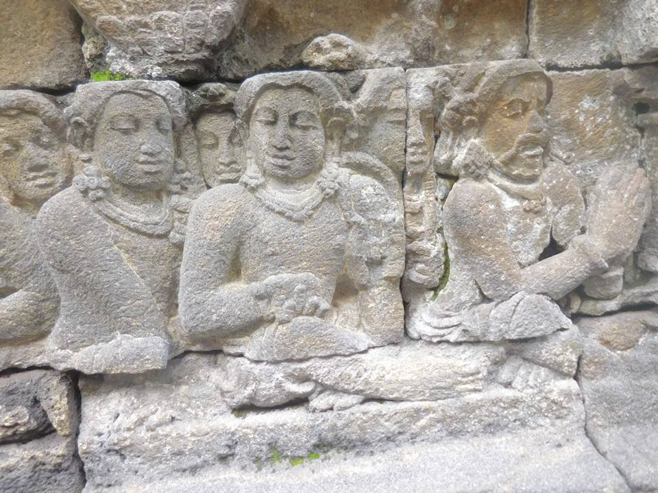 Carvings on the stone wall of Borobudur Central Java