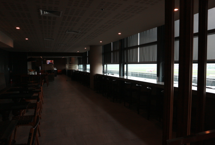 Chairs and tables inside ANA Lounge Manila International Airport.