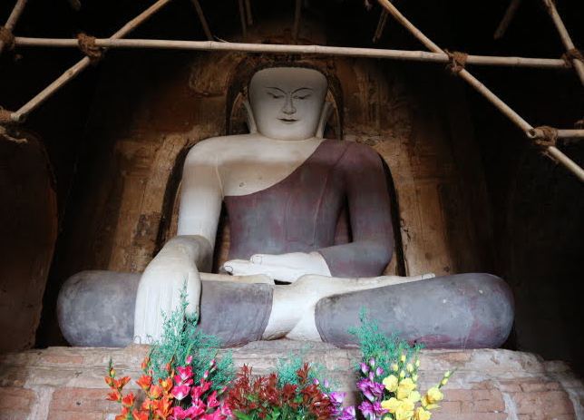 The huge sitting buddha on the lower ground.