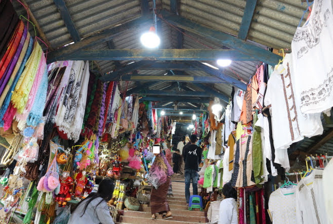 The vendors at the stairs ot Mount Popa.
