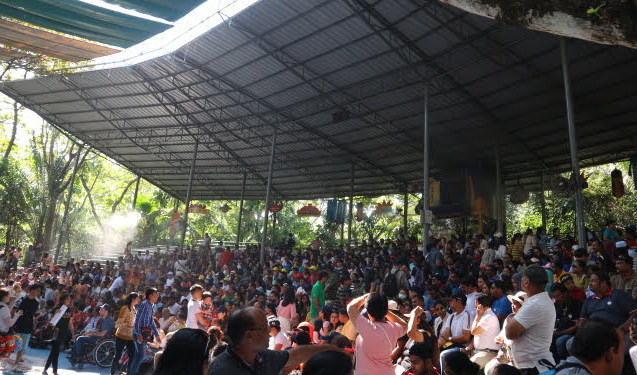 The audience anticipating the orangutan show at Safari world, Thailand.